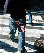 Pedestrian with American flag in pocket