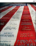 A quilt fashioned after a US flag bears the names of 346 firefighters who died 11 September