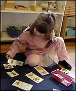 girl playing with puzzle