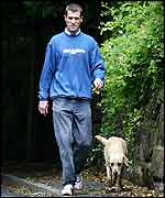 Keane walks his dog after his much-publicised spat with the Irish management
