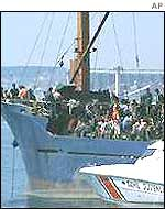 The Turkish coastguards intercept a boat with suspected illegal immigrants on board in 2001