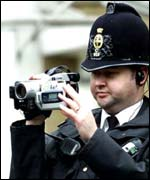 Policeman using video camera, PA