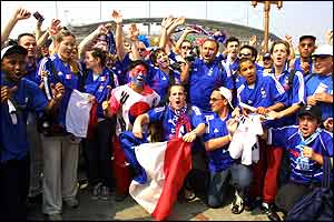 French fans cheer outside the stadium in Seoul