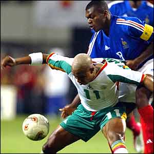 France captain Marcel Desailly challenges Senegal's El Hadji Diouf