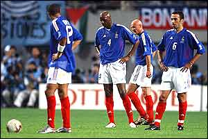 Thierry Henry, Patrick Vieira, Frank Leboeuf and Youri Djorkaeff look forlorn after Senegal's goal