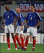 Patrick Vieira, Frank Lebouef and Youri Djorkaeff hang their heads after Senegal score