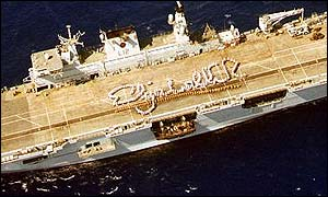 The ship's company on HMS Ocean, the Royal Navy's largest vessel, mark out Elizabeth R on deck