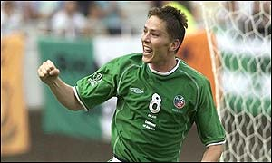 Matt Holland celebrates equaliser for Ireland