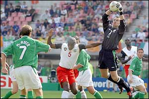 Shay Given claims a cross under pressure from Kalla -AP