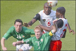 Gary Breen (left) and Steve Staunton try to keep out Cameroon