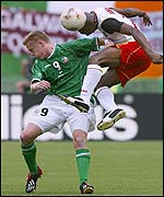 Damien Duff and Bill Tchato in aerial challenge