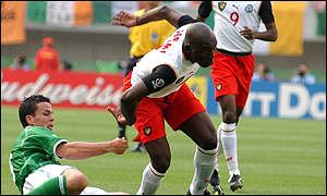 Geremi is tackled by Ian Harte