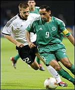 Saudi Arabia forward Sami Al-Jaber is tackled by Germany midfielder Torsten Frings
