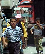Palestinian boys near the checkpoint