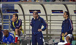Zinedine Zidane (centre) watches France's defeat by Senegal