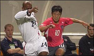 England's Trevor Sinclair is challenged by Lee Young-Pyo