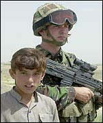 A member of Operation Buzzard and an Afghan boy