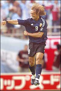Argentinian forward Gabriel Batistuta celebrates after scoring their first goal of the campaign