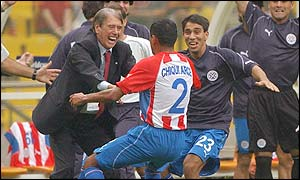 Paraguay coach Cesare Maldini celebrates with Francisco Arce after the defender gave his side a 2-0 lead