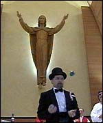 A Juggler performs in the church