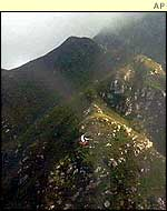 Plane wreckage lies on mountainside