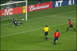 Spanish captain Fernando Hierro strokes in his 28th goal for his country