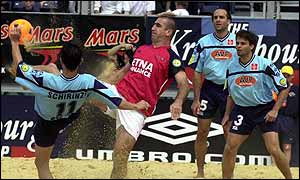 Cantona in action playing beach football