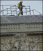 Fire fighter on palace roof