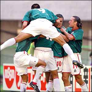 Mexico players celebrate after Blanco's penalty put them ahead