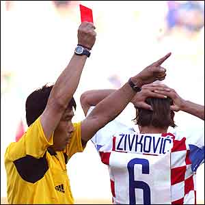 Croatia's Boris Zivkovic is shown the red card