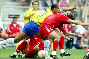Rivaldo signals to the referee following a tackle from Bulent Korkmaz