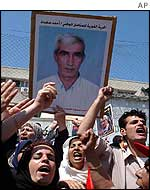 Supporters carry poster of Ahmed Saadat in Gaza