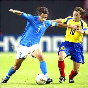 Italy's captain Paolo Maldini fends off Ecuador's skipper Alex Aguinaga