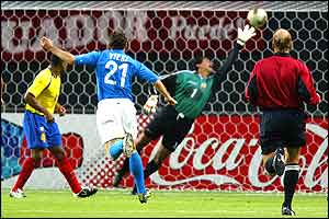 Christian Vieri slots the ball into the top corner for Italy's opening goal
