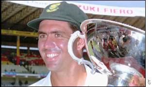 Cronje holding winners' trophy after test series in India, March 2000