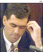 Cronje reading his submission to the King Commission
