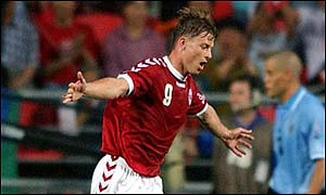 Jon Dahl Tomasson celebrates scoring against Uruguay