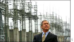 President Bush in front of a power plant