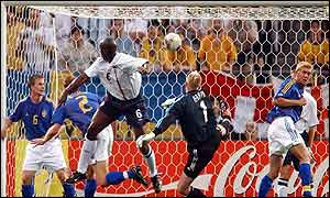 Sol Campbell beats Magnus Hedman to the ball to give England the lead against Sweden
