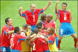 Costa Rica players celebrate their first goal against China during their opening Group C clash
