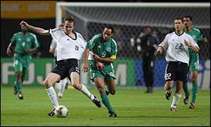 Sami Al-Jaber (centre) gets to grips with Dietmar Hamann