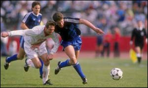 Peter Vermes (right) in action in his international playing days