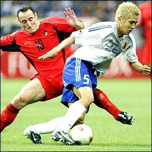 Arsenal's Junichi Inamoto clashes with Belgium's Yves Vanderhaeghe