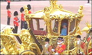 Duke of Edinburgh and Queen in gold state coach