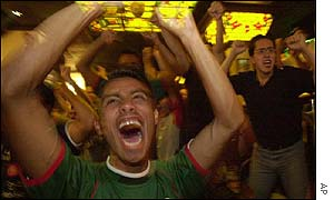 A Mexican supporter celebrates the win in a bar in Mexico City