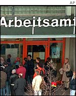 People queue outside German job centre