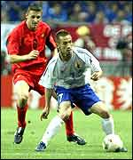Hidetoshi Nakata holds the ball up for Japan