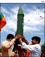 BJP youth wing members hold up a dummy of India's nuclear capable, Agni-3 missile