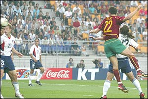 Portugal's Beto scores for his team as USAs Brian Mc Bride