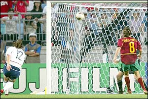 USA's Jeff Agoos scores an own goal as Portugal's Joao Pinto looks on